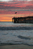 American flag flies over Ventura Pier at sunset, Ventura, California, USA Royalty Free Stock Photo