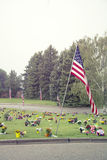 American flag and Flowers on Graveside Royalty Free Stock Image