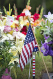 American flag and Flowers on veteran Graveside Stock Images