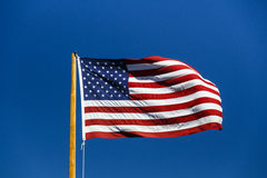 American flag fluttering in blue sky, USA, 2015 Stock Images