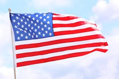 American flag fluttering outdoors. On cloudy day stock photos