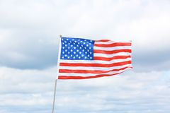 American flag fluttering outdoors. On cloudy day royalty free stock photography