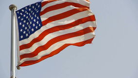 American flag is fluttering in wind. stock footage