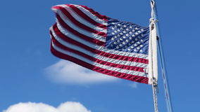American flag fluttering on windy day stock video