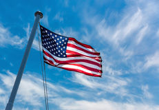 American Flag. Flying against a blue sky Stock Photo