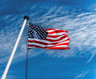 American Flag. Flying against a blue sky Royalty Free Stock Photo