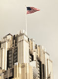 American flag on skyscraper Stock Photos