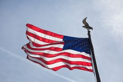 American Flag. Flying in blue sky in the springtime royalty free stock images