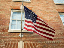 American Flag Flying on Brick Building Royalty Free Stock Images