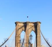 American flag flying on the Brooklyn Bridge Stock Photo