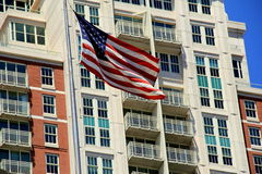 American flag flying in front of beautiful architecture Royalty Free Stock Photography