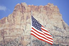 American Flag Flying in front of Mountain, Southwest United States stock photo