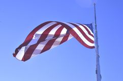 American flag flying at half staff or half mast. Honoring the dead during a national lost or grief of the nation the American flag is lowered to half staff or royalty free stock photos