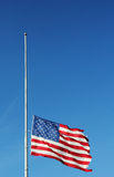 American flag flying at half staff in memory of Newtown massacre victims . American flag flying at half staff in memory of Newtown massacre victims.  President Stock Photo