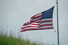 The American Flag Flying Over a Field Stock Image