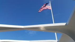American Flag flying at Pearl Harbor. American flag flying over the USS Arizona Memorial at Pearl Harbor Stock Photos