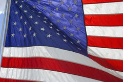 American flag flying proudly on a windy day Royalty Free Stock Photos