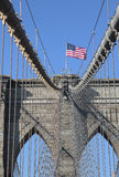 American flag on top of famous Brooklyn Bridge Royalty Free Stock Photography