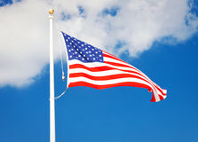 American flag flying in the wind Royalty Free Stock Photos