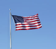 American flag flying in the wind Royalty Free Stock Photography