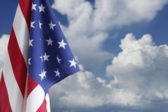 American flag in sky. American flag in front of blue sky Stock Images