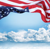 American flag. In front of blue sky Stock Images