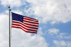 American Flag in front of Cloudy Blue Sky Royalty Free Stock Photo