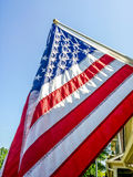 American Flag on Front of Home Royalty Free Stock Image