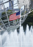 American flag in the front of 1964 New York World s Fair Unisphere Royalty Free Stock Images