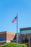 American Flag in Front of Old Brick Building Royalty Free Stock Image