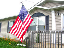 American Flag on Front Porch. American Flag hung proudly on Front Porch Stock Images