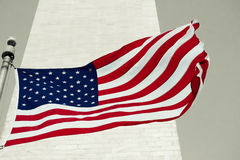 American flag in front of the Washingtom Monument in Washington Royalty Free Stock Image