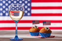 American flag, glass of white wine and cupcakes. American flag, glass of white wine and cute cupcakes Stock Images