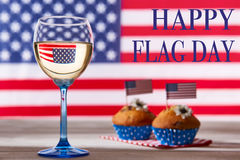 American flag, glass of white wine and cute cupcakes. Happy flag day background Royalty Free Stock Photography