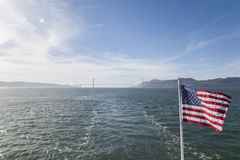 American flag with golden gate bridge. American flag from ferry with the view of Golden Gate Bridge in San Francisco, California Stock Photography
