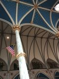 American Flag in the Gothic-Revival Cathedral of Saint John the Baptist - SAVANNAH - GEORGIA. Savannah, a coastal Georgia city, is separated from South Carolina royalty free stock photography