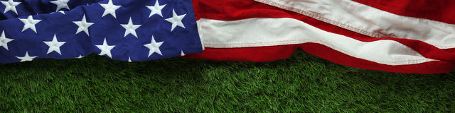 American flag on grass for Memorial Day or Royalty Free Stock Images