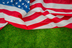American flag on green grass. Royalty Free Stock Photos