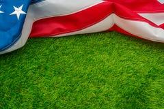 American flag on green grass. Stock Photos