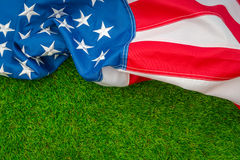 American flag on green grass. Royalty Free Stock Image