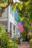 American Flag on Green Shuttered House. Traditional wood siding home in Florida with American flag Stock Photography