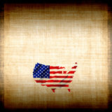 American Flag Grunge. Burlap canvas fabric background with the map of America shaped into the United States Of America flag in red, white, and blue all in stock illustration