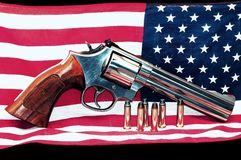American flag and gun. Image of American flag and revolver. Can be used to symbolize freedom and gun rights in the United States stock images