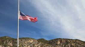 American flag at half-mast stock video