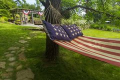 American flag hammock. Hammock with US flag design, in a backyard on a summer day Stock Photos