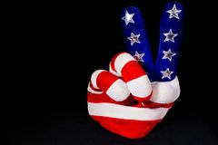 American Flag Hand Peace Sign. A hand made of the American Flag giving the peace sign on a black background. Covers politics, government, peace, hippies, love stock photography