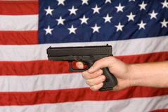 American flag and handgun Royalty Free Stock Images