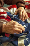 Hands on American flag Royalty Free Stock Photos