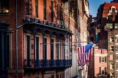 American flag hanging from a building in Boston, Massachusetts. Stock Photo