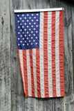 American flag hanging on gray barn wood Royalty Free Stock Photos